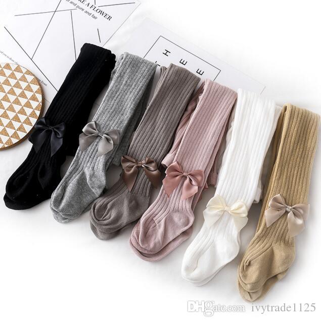 polainas color sólido del INS pantalones pantalones de punto ropa de la muchacha con el arco Leggings otoño resorte de la muchacha