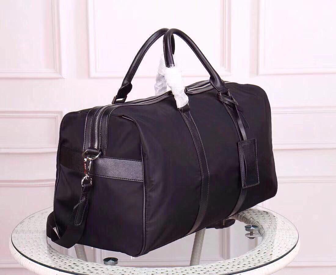 Tasche Qualität Top Männer Duffle Duffel Totes für neue klassische Leinwand Gepäcktaschen für Mann Leder Großhandel Handtasche Mode Reisetasche Rshxs