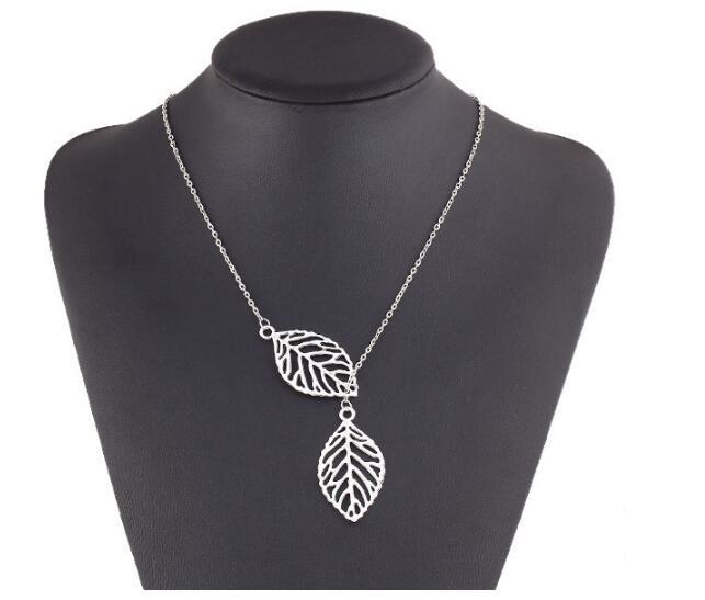 Fashion-Punk Gold Hollow Два листьев ожерелье ключицы цепи Простой нового европейского шарма способа ювелирных изделий женщин Рождественский подарок
