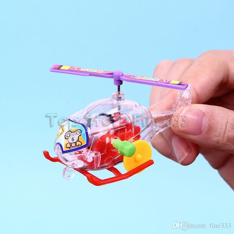 Corrida de Helicóptero de Brinquedo Wind-up Brinquedos cor Aleatória Transparente brinquedo de Avião de plástico Para O Bebê e Crianças Wind-up Helicóptero Atacado