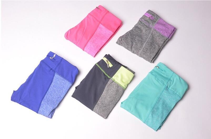 Frauen hohe elastische schnell trockene Yogahosen Sport Fitness Strumpfhosen schlank Sport Leggings Laufsportbekleidung mit Reißverschluss Gesäßtasche # 544386