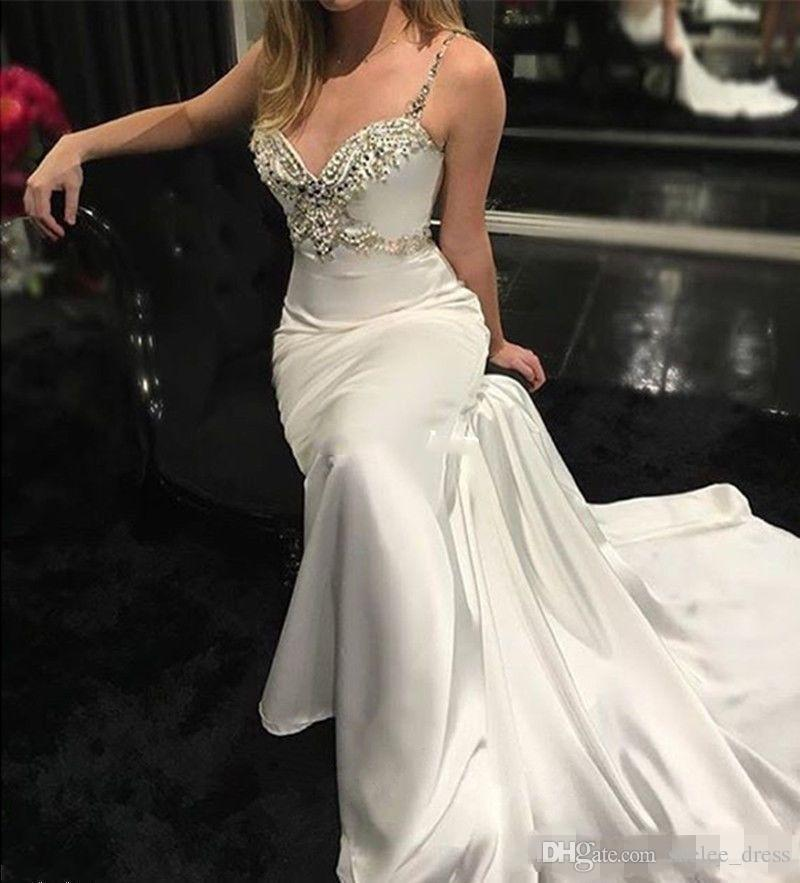 2020 Sexy Ivory Mermaid Wedding Dresses Luxury Beaded Crystal Backless Spaghetti Straps Satin Ruched Beach Wedding Bride Party Gown