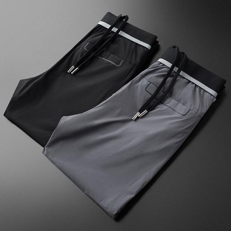 Neue Sommer-dünne Mens Pants Luxus Schwarz Grau Solid Color Casual Male Hose plus Größe 40 Elastic Waist Slim Man Hose