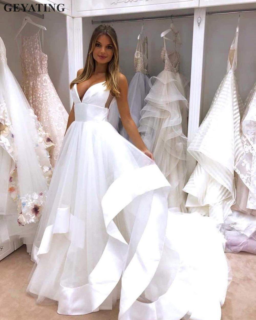 f4d5130af Sexy Spaghetti Straps Open Back Wedding Dress 2019 White Satin Ruffles  Puffy Tulle A-line Beach Bridal Gowns Cheap Made in China
