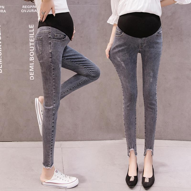 Irregular Tassel Leg Hem Pregnant Women Belly Jeans Maternity Skinny Denim Pants Office Lady Elegant Fashion Cotton Trousers