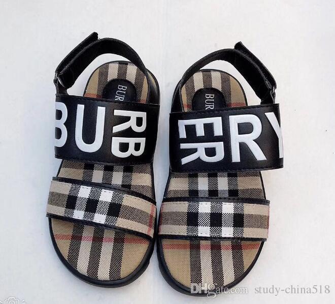 2009 صيف جديد وهان الطبعة الأوسط أحذية الأطفال لينة سوليد أحذية مسطحة سوليد مفتوحة الأصابع الشاطئ