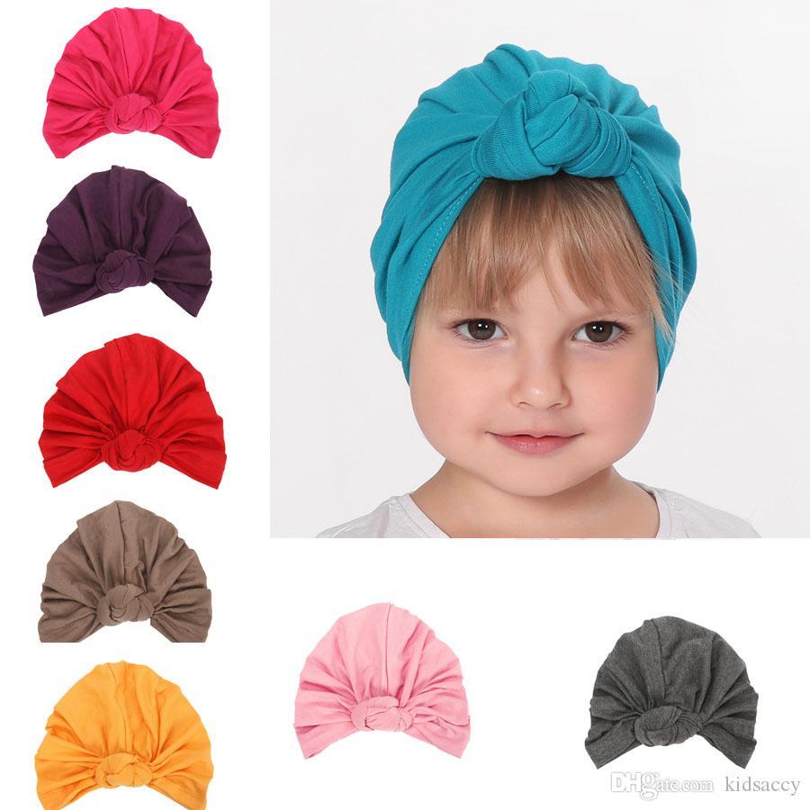 Европа Infant ребёнки Hat Узел Хлопок Деревообрабатывающий по уходу за детьми малышей Детские шапочки Тюрбан шапки Детские аксессуары 12 цветов A420