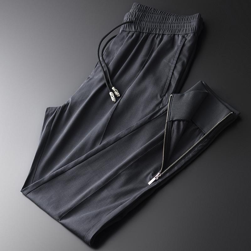 Nouveau Lyocell Hommes Pantalons Pied Bouche Zipper conception Pantalon Hommes Drawstring Taille Plus 4XL taille élastique Slim Fit Pantalons Hommes