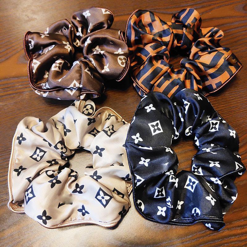 Heißer Verkauf Frauen Designer Brief Haar Gummiband Bowknot Brief elastischer Haar-Seil-Pferdeschwanz-Halter-Luxus-Haarschmuck Geschenk