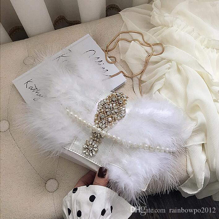 Factory wholesale women handbag new hand sewn Turkey hair chain bag sweet lovely diamond fur bag pearl decoration diamond Dinner Bag