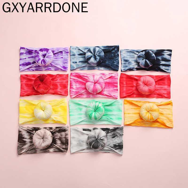 20pc / lot 2020 Yeni Batik Baskılar Yuvarlak Knot Naylon Bebek Headwraps Batik Gökkuşağı Renkli Kızlar Donuts Turban Bun Kafa Şapkalar