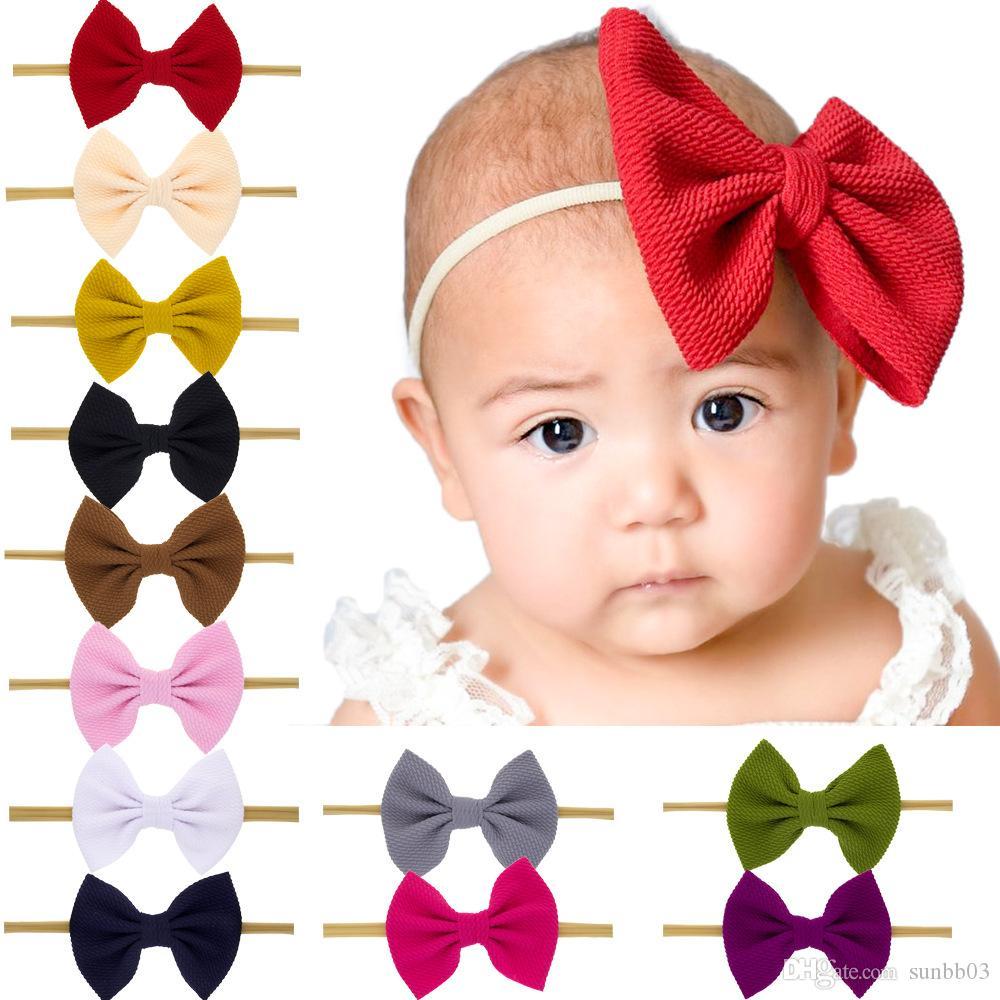 Nueva Europa bebés del arco de la venda de los niños del Bowknot Hairband niños Pañuelos Head Band 12 colores 15022