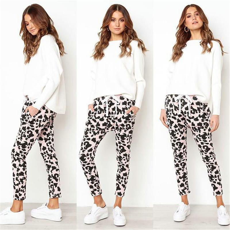 Otoño nueva venta caliente mujeres estampado de leopardo largo deporte Fitness pantalones planos Casual suelta moda Sexy señoras Mediados de cintura Harem pantalones Y200418