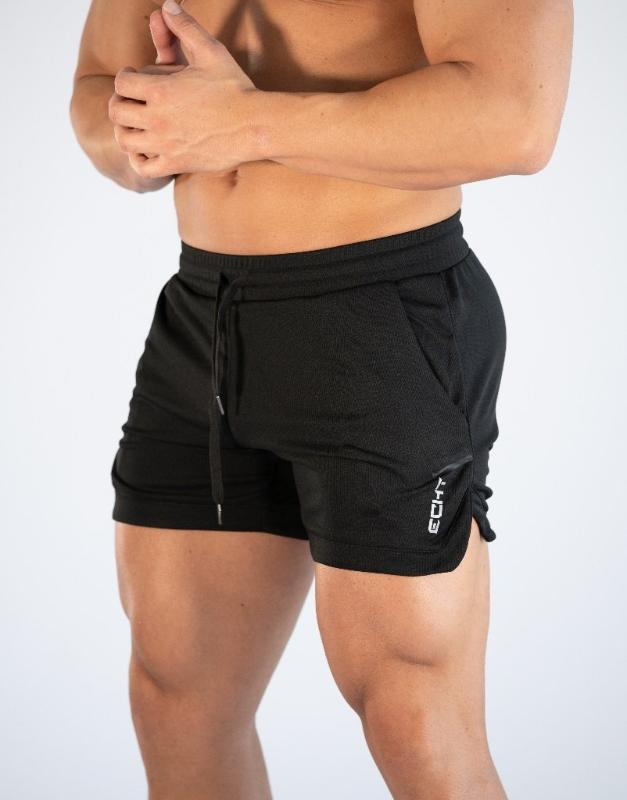 Musculares pantalones nuevos hermanos paquete deportivo cortocircuitos de los hombres ocasionales de la aptitud delgada que se ejecutan pantalones de entrenamiento transpirables
