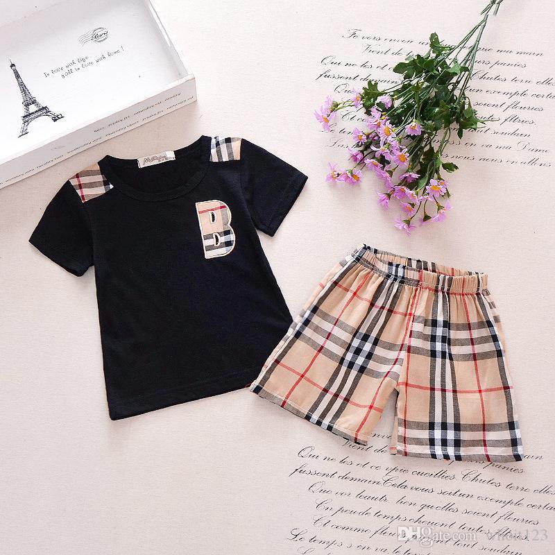 Spring Baby Boy девушка клетки для клетки кармана с короткими рукавами + клетчатые шорты 1-7 лет костюм детские детские 2 шт.