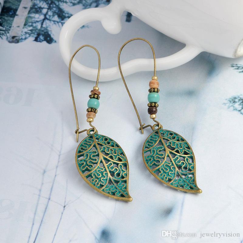 Hot Fashion Jewelry Vintage Hollow Out Leaf Bead Dangle Earrings Women's Earrings S228