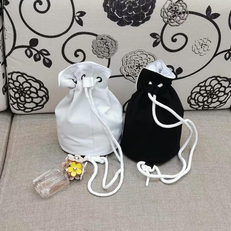 Classic black and white Famous fashion C Women Waterproof storage bag Drawstring Beam cosmetic bag Cylinder finishing bag party gift
