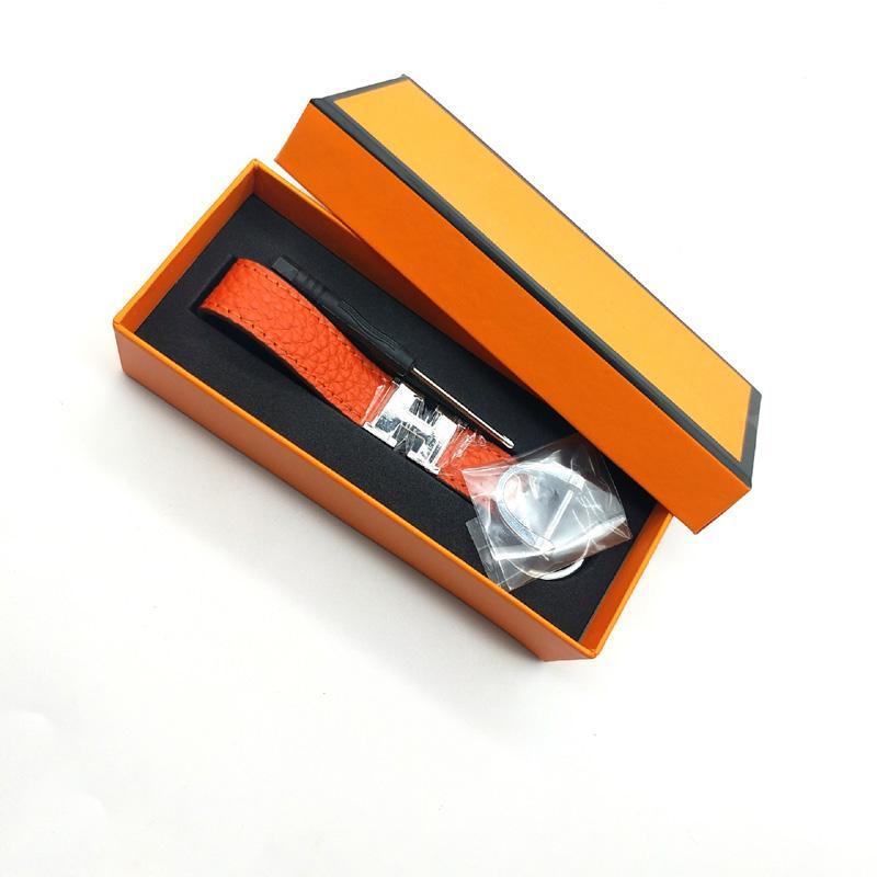 Moda de cuero real llavero 2020 llavero unisex de diseño con llavero de acero inoxidable llavero en oro blanco con negro