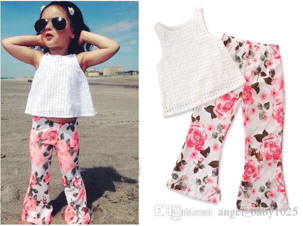Novo terno das crianças da moda verão menina branca manta oco camisa sem mangas + calças florais de duas peças