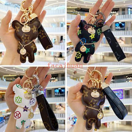 Новый высококачественный кожаный брелок творческий мужской женский медведь брелки Мужчины Женщины пары персонализированные ключи от автомобиля подвески Бесплатная доставка