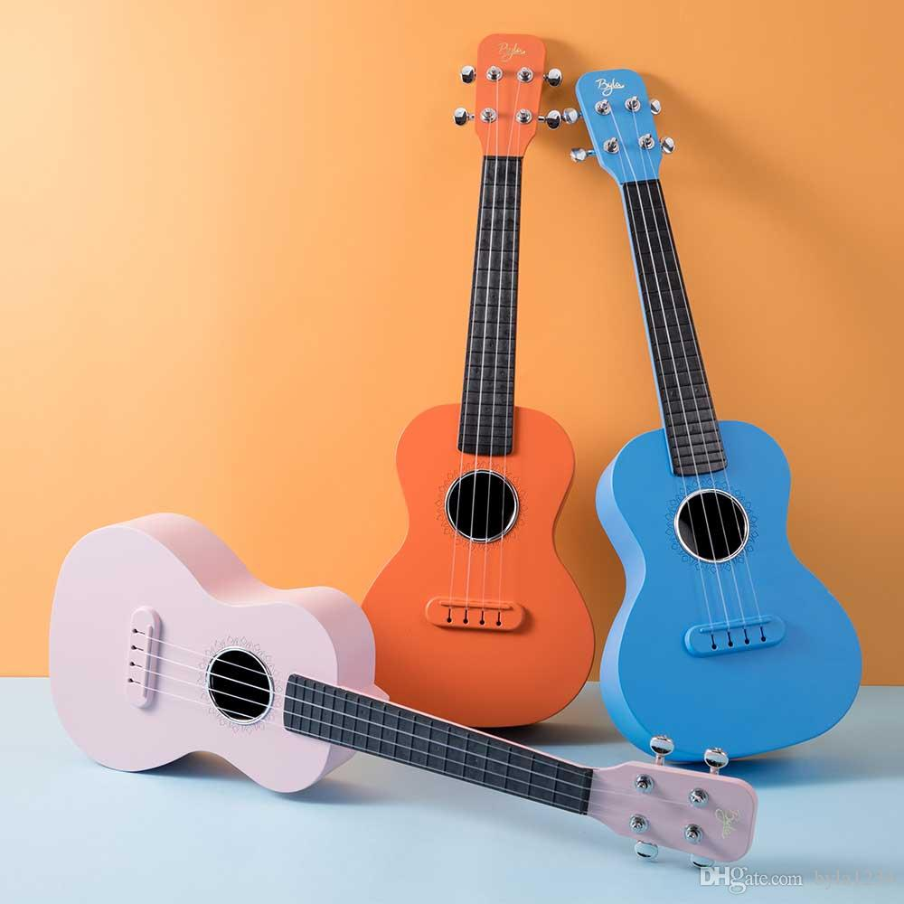 Byla por mayor de fibra de carbono de 23 pulgadas Ukulele de 5 colores estructura integrada a prueba de agua al aire libre con los accesorios de instrumentos musicales