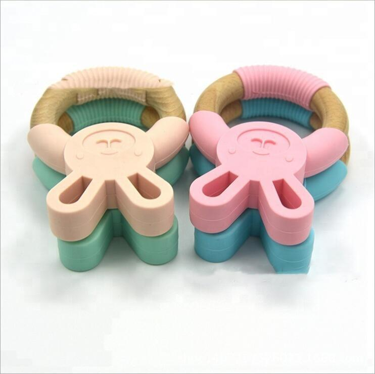 Infant Tétines Anneau de dentition en silicone formation Teething en bois Chewing Jouet Lapin Chewing Gum Food Grade sensorielle Jouet Sucettes C7424