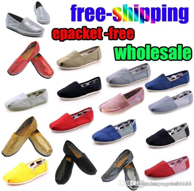 Cadeau gratuit en gros Mode Femmes paillettes solides Appartements Chaussures Sneakers femmes et des hommes Chaussures de toile mocassins chaussures de sport Espadrilles