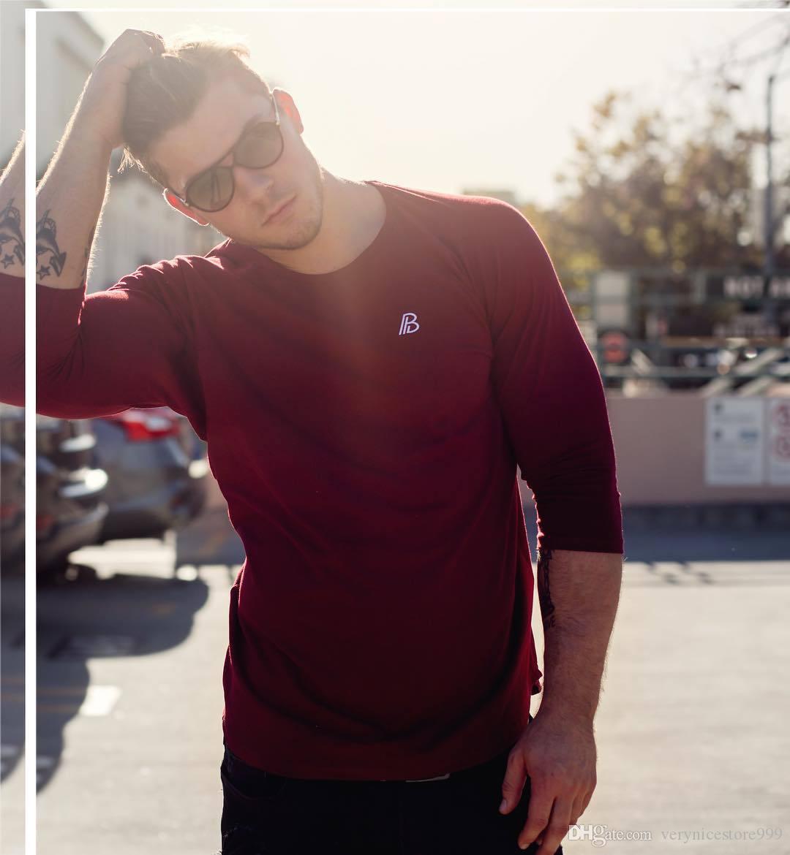 Automne et d'hiver d'homme sport mince broderie long T-shirt tendance Pull couleur pure Vente chaude