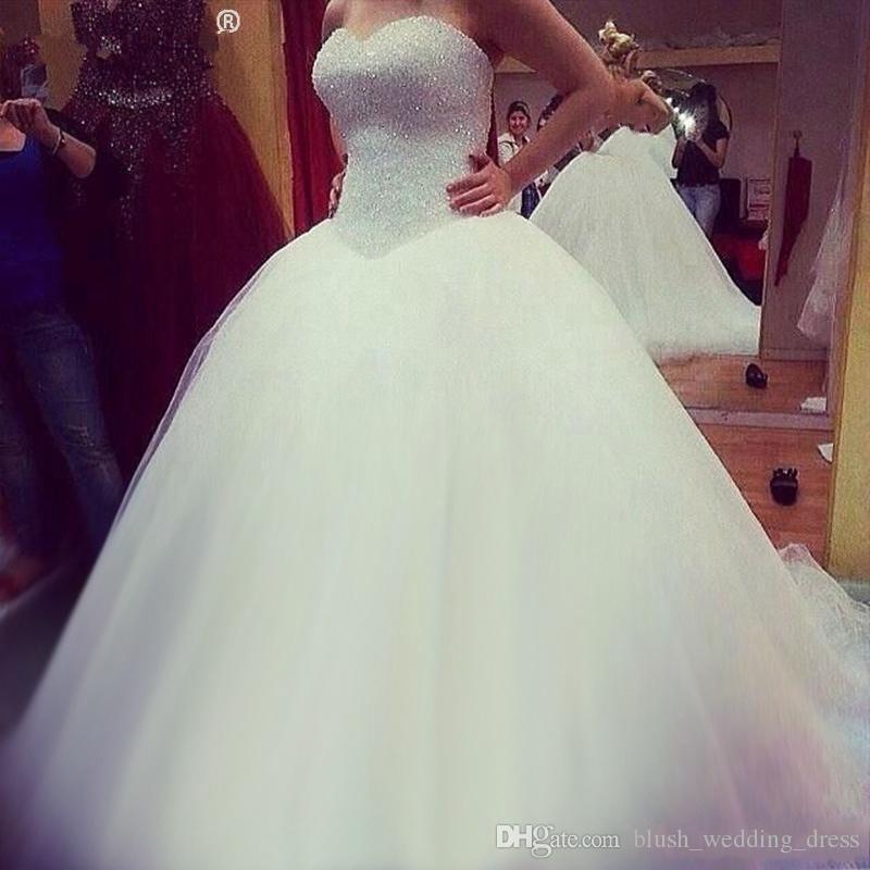 أبيض أنيق الكرة ثوب الزفاف فساتين الحبيب Sleevelesss قطار الاجتياح الدانتيل متابعة الحلو فساتين الزفاف وأزياء فساتين DH352