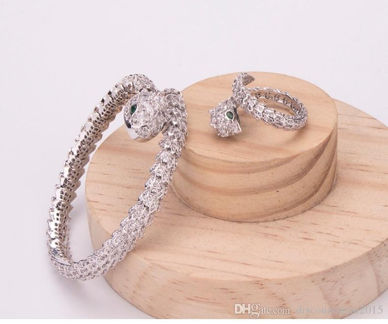 حار بيع أزياء العلامة التجارية مجموعات المجوهرات سيدة النحاس الماس الكامل عيون خضراء ثعبان 18k الذهب الاشتباك خواتم الزفاف خواتم الخطبة مجموعات (1sets)