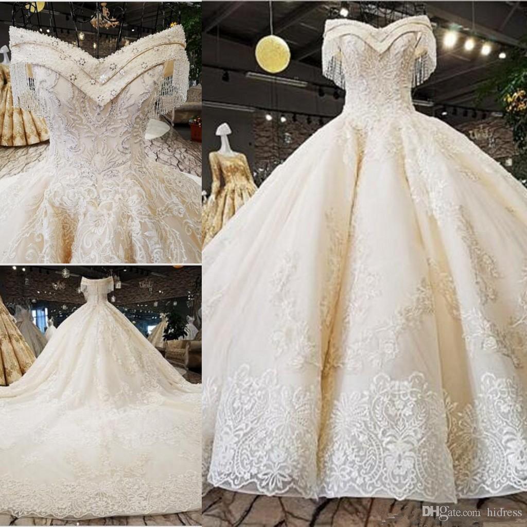 Lujoso escote de pico fuera del hombro una línea de vestidos de novia apliques de abalorios vestidos de novia de novia más tamaño de Oriente Medio