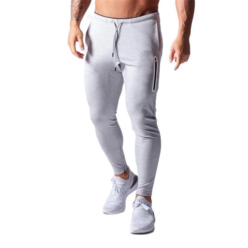 Compre 2021 Pantalones Ocasionales De Los Mas Nuevos Hombres De La Llegada Del Color Solido De Cintura Alta Pantalones Deportivos Fitness Deportivo Casual Pantalones Negro Gris Cyan Colores A 16 98