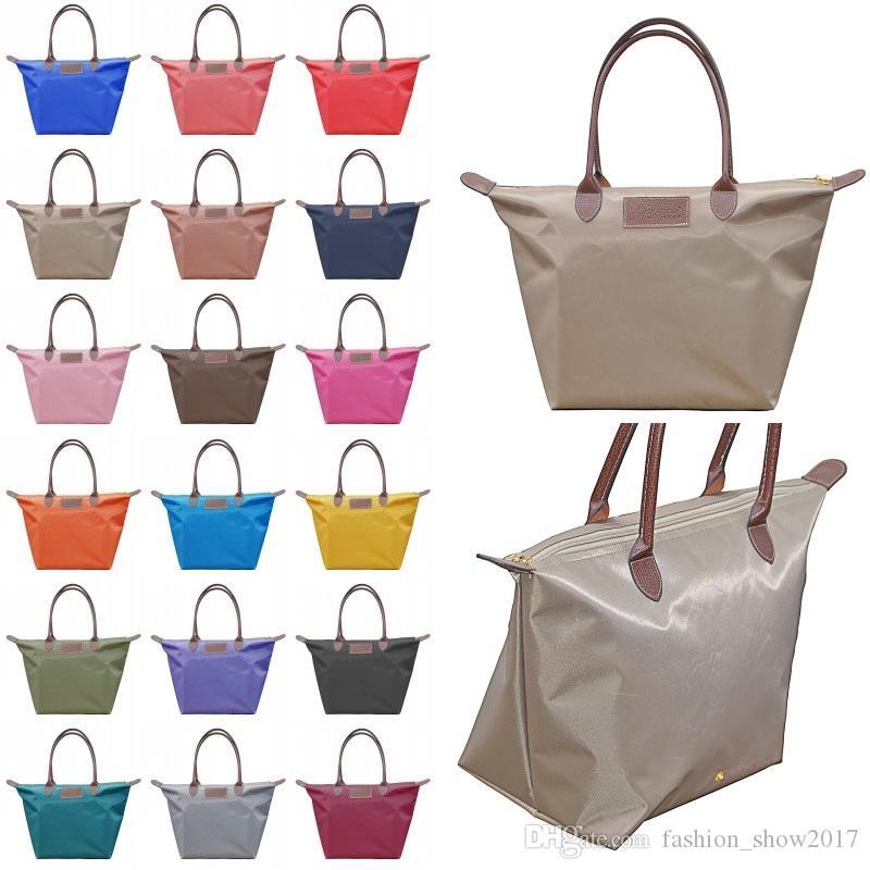 18 ألوان زلابية حقيبة يد المرأة كاندي اللون قابلة للطي حقائب مستحضرات التجميل حقيبة تخزين للماء حقائب التسوق