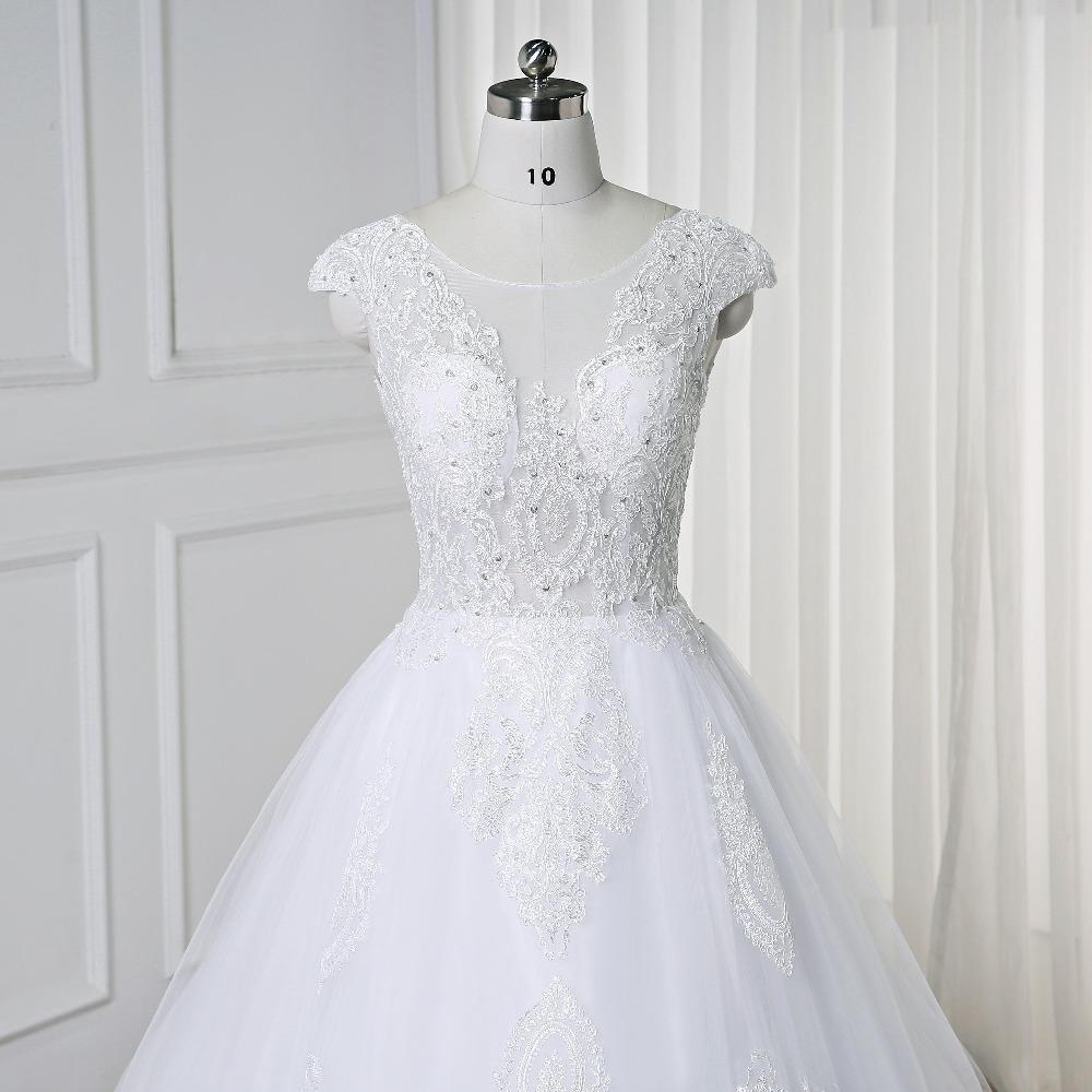 Großhandel Luxus Appliques Kapelle Zug Ballkleid Brautkleid 12 Spitze  Flügelärmeln Rückenfreies Brautkleid Vestido De Noiva Princesa Von