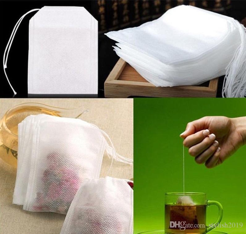 حار جديد 100 قطعة / الحزمة teaBags 5.5 × 7 سنتيمتر فارغة عطر أكياس الشاي مع سلسلة شفاء ختم ختم ورقة فلتر ل عشب الشاي فضفاض bolsas WCW220