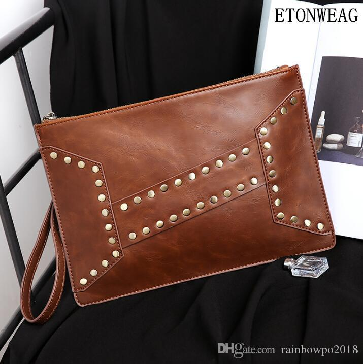 Factory wholesale men handbag stylish cool rivet punk hand clutch bag vintage leather wrist bag imitation old leather hand clutch envelope b