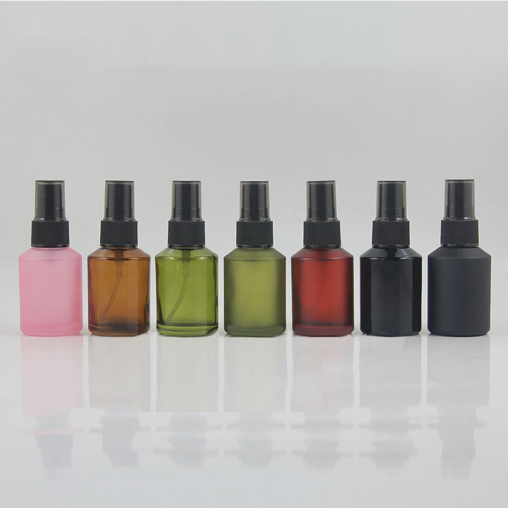 Wholesale colored glass 1oz spray bottle, frosted glass mist pump bottle with black plastic cap, empty glass perfume bottle