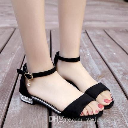 "Open-toe flat bottom with rhinestone belt buckle Roman style sandals for women spring/summer 2019, the new Korean chic ""chic"" button is vers"