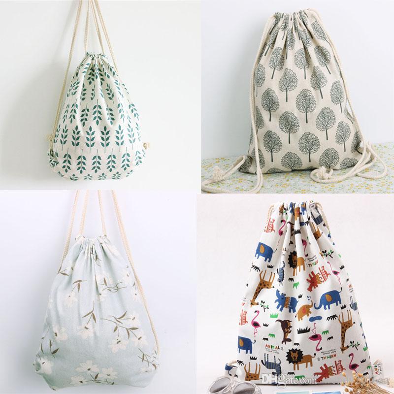 50pcs / lot 2017 New Brief coton lin sac à dos style femmes fille étudiant rayé cordon sacs à bandoulière coloré sac à bandoulière