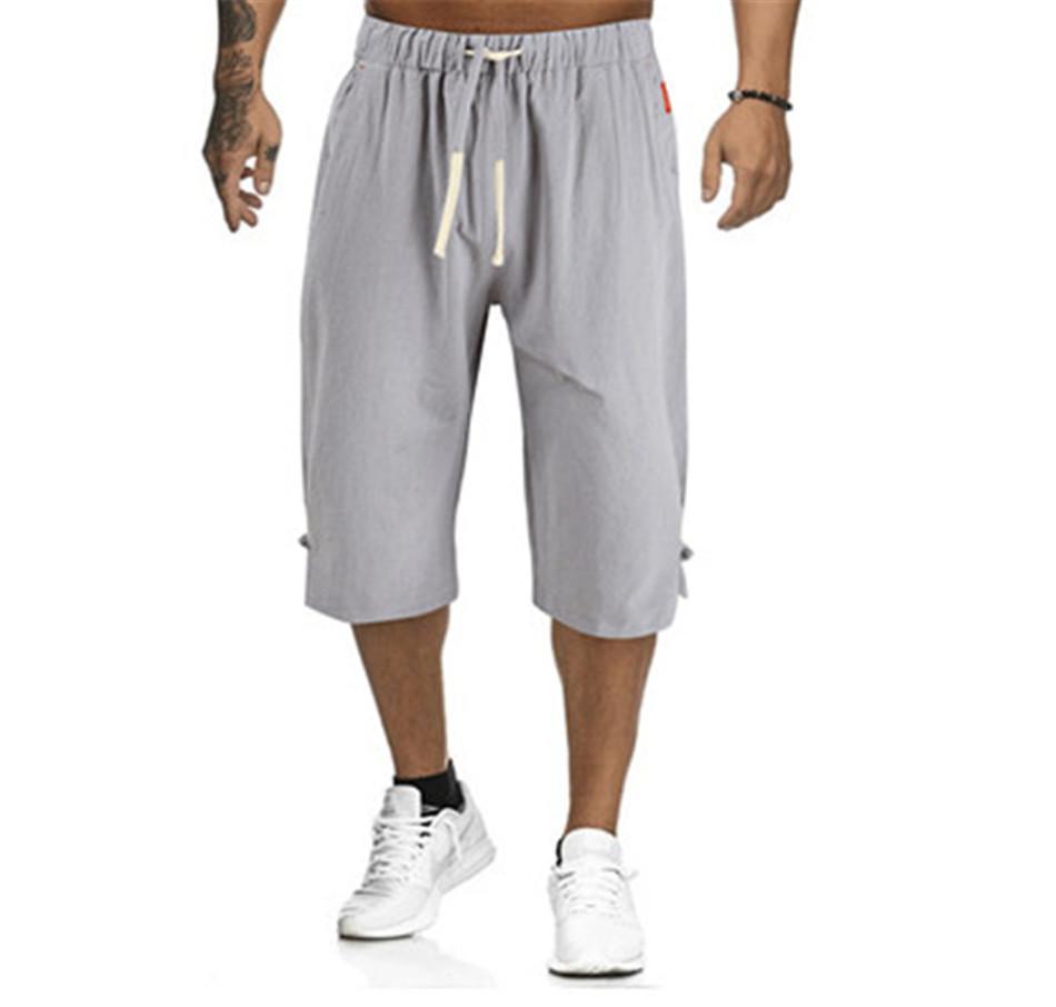 Desenhador Mens linho Mistura calças sólida Casual Cor solto cordão Mens Capris Mid cintura Homme Vestuário