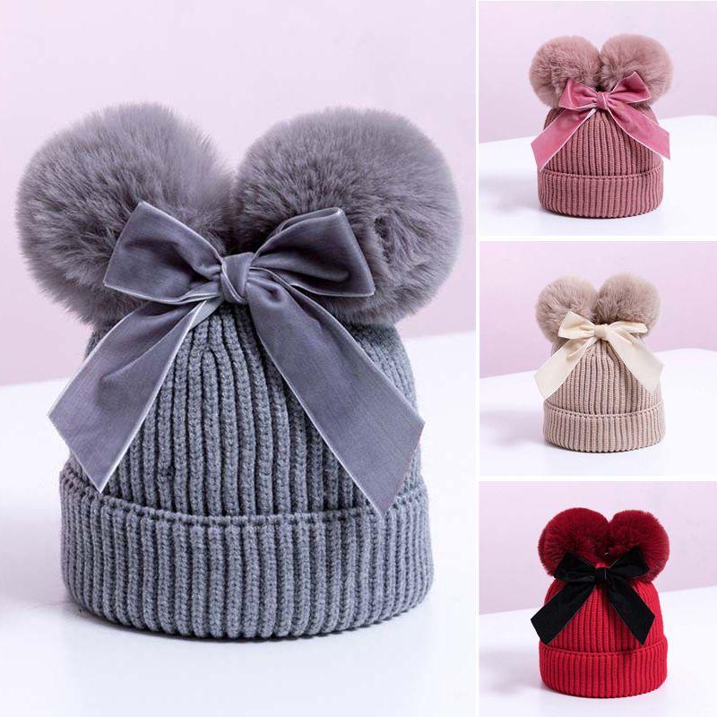 Doble Pompón Bebé lindo del sombrero del arco hecha punto invierno de los niños del bebé sombrero caliente del invierno más grueso infantil Niños Beanie Cap niñas Capó
