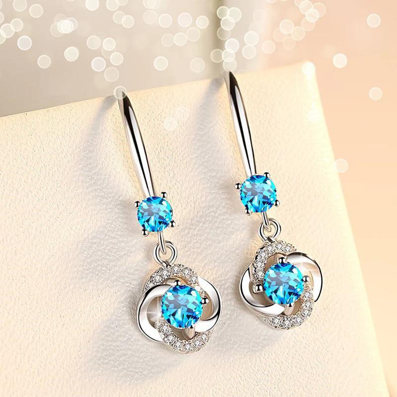 Fleur blanche / bleu / rose boucles d'oreilles à long tempérament bohème forage en verre rétro Europe Etats-Unis bijoux de mariage pour les femmes cadeau