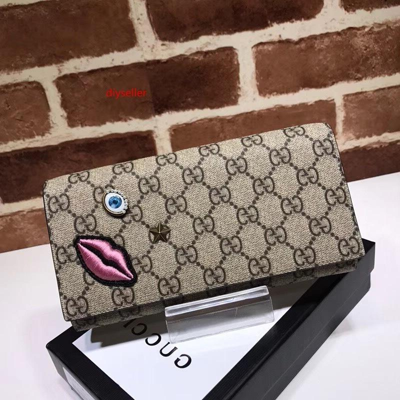 2020 de calidad superior diseño de la celebridad Carta Labios gofrado ojos de estrella bordado Cartera de piel Tarjetas Paquete lienzo bolso de embrague 428736