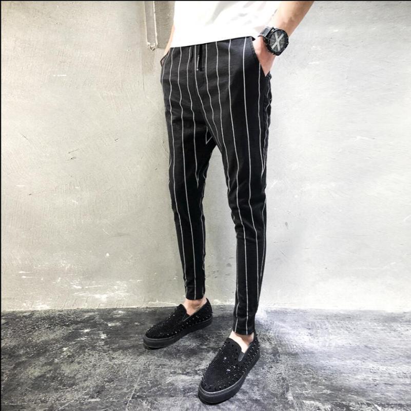 M-5XL 2020 pantalones del resorte nuevas de la manera Negro y negro a rayas costura de los hombres delgados pies pantalones casual Cordón pantalones harén
