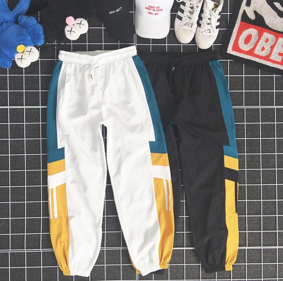 Nuevos pantalones para hombre Pantalones con patrón con paneles flojo con cordón deporte pantalones casuales nueve puntos pantalón para mujer del hombre