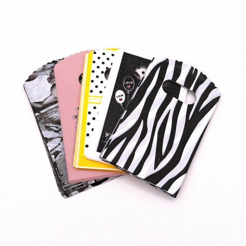 New Designs Wholesale 9*15cm Mini Plastic Boutique Candy Packing Bag Small Plastic Gift Bags With Handles nYCa#