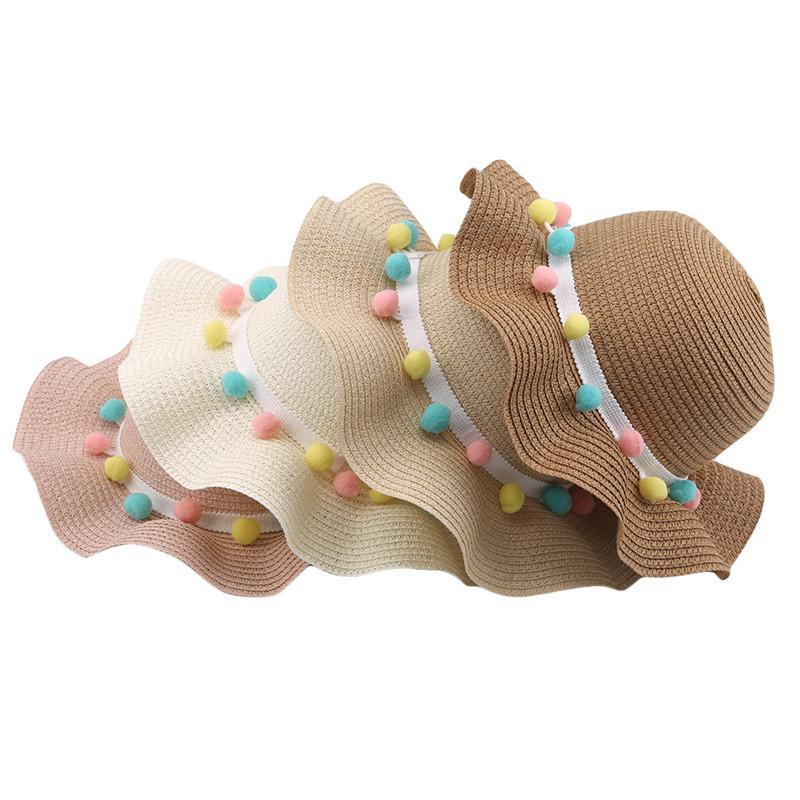 Dulces de las señoras Sunhat mujeres de Sun sombrero del cubo del casquillo del sombrero de paja playa Caps Bowknot de las flores de cinta plano superior para damas