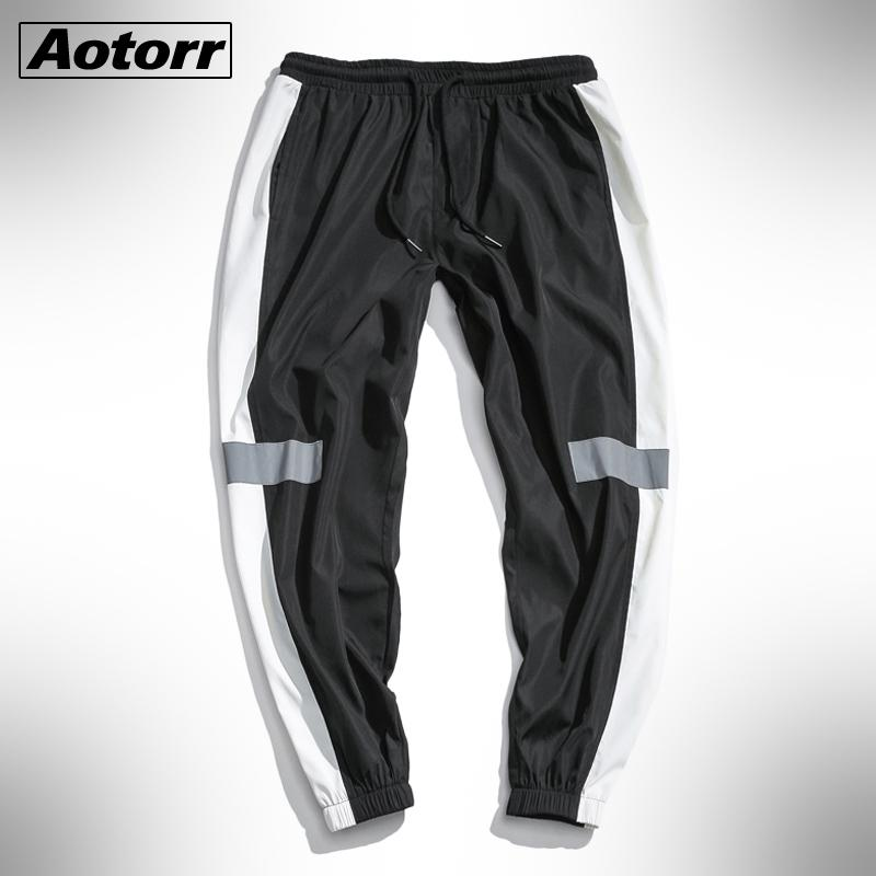 2020 Mode Hommes en vrac Jogging sport poches Casual Sweatpants Pantalons Homme Pantalons Side Stripes Pantalons Hip Hop Survêtement Bottoms