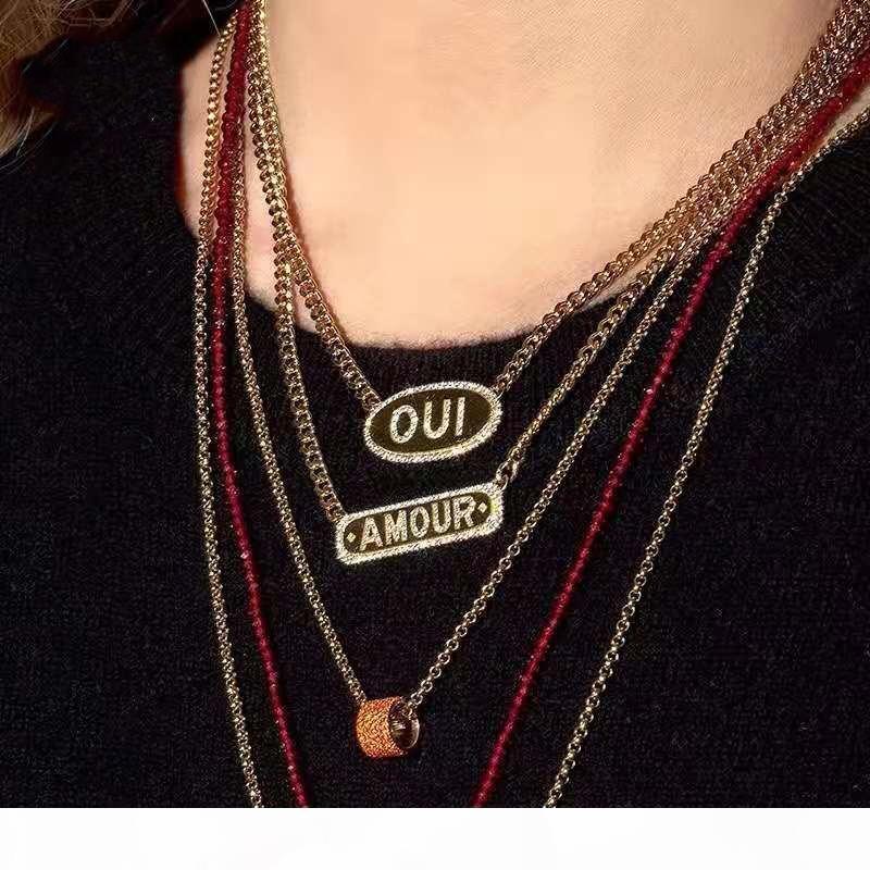 Европа и Америка Новая мода Модные женщины ожерелье желтого золота гальваническим CZ Письмо тегов ожерелье для девочек Женщины Nice подарков