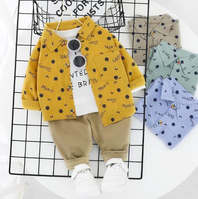 resorte de los niños traje y nuevo juego de la manga larga cara sonriente de impresión pleno otoño pantalones con capucha de dos piezas, una por tema